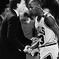 Michael Jordan Talks With Coach by Retro Images Archive