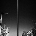 millennium needle spire of dublin monument of light and dublin bus in road in O'Connell Street Dublin by Joe Fox