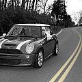 Mini-cooper Car Driving On Double Yellow Country Road by Nicole Berna