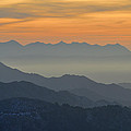 Mists In The Mountains At Sunset by Guido Montanes Castillo