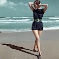 Model Wearing A Blue Swimsuit On A Beach by Serge Balkin
