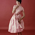 Model Wearing A Pink Satin Dress by Frances McLaughlin-Gill