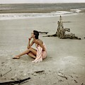 Model Wrapped In A Pink Towel On The Beach by Frances McLaughlin-Gill