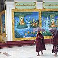 Monks In Rain At Shwedagon Paya Temple Yangon Myanmar by Jacek Malipan