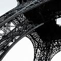monocrome leg of Eiffel tower by Remi D Photography
