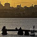 Montevideo - Fishing At Dusk - Playa Ramirez by Carlos Alkmin