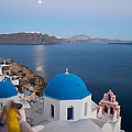 Moon Over Blue Domed Church In Oia Santorini Greece by Matteo Colombo