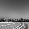 Moon Over Ice Road by Ismo Raisanen