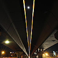 Moon Visible Between The Flyover Gap by Sumit Mehndiratta