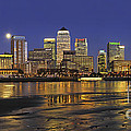 Moonrise Over River Thames Flowing Past Canary Wharf by Frank Kletschkus