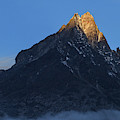 Moonset And Alpenglow Over A Snow Peak by Jeff Dai
