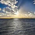 Morning Sun Punching Through The Clouds In St. Croix by Craig Bowman