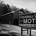 Motel Sign In Black And White by Kelly Hazel