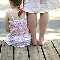 Mother And Daughter On A Wooden Board Walk by Lee Avison