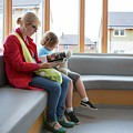 Mother And Son In Waiting Room by Lewis Houghton/science Photo Library