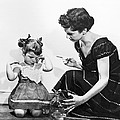 Mother Scolding Tearful Child by Underwood Archives