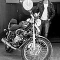 Motorbiker Looks On Dotingly by Kantilal Patel