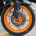 Motorcycle Wheel by Les Palenik