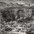 Mountain Stream With Bridge by Roberto Pagani
