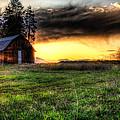 Mountain Sun Behind Barn by Derek Haller