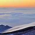 Mountains Clouds At Sunset by Guido Montanes Castillo