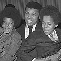 Muhammad Ali With Young Michael Jackson by Brian Douglas