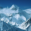 Mustagh Tower At Center And Masherbrum by Colin Monteath