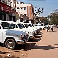 Mysore Taxis by Carol Ailles