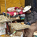 Nap Time For Child And Street Shopkeeper In Lhasa-tibet   by Ruth Hager