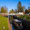 Narrowboat In Lock by Mark Llewellyn