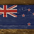 New Zealand National Flag On Wood by Movie Poster Prints