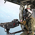 Naval Aircrewman Mans A .50-caliber by Stocktrek Images