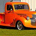 Neat Vintage Chevrolet Truck In Bright Orange by Eti Reid