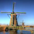 Netherlands, Kinderdijk, Sunrise by Terry Eggers