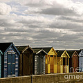 Colourful Wooden English Seaside Beach Huts by Toula Mavridou-Messer