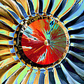 Close Up Power Of A Red And Gold Propellor by Toula Mavridou-Messer