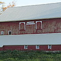 New White Roof  Old Red Barn by Tina M Wenger