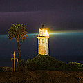 Night Lighthouse On The Bluff by Jerry Cowart