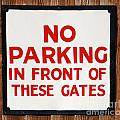 No Parking Vintage Sign by Luis Alvarenga