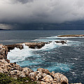 Wild Rocks At North Coast Of Minorca In Middle Of A Wild Sea With Stormy Clouds by Pedro Cardona Llambias