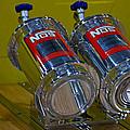 Nos Bottles In A Racing Truck Trunk by Eti Reid