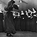 Nun Swivels Hula Hoop On Hips by Underwood Archives