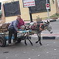 Off To Market In Port Said Egypt by Jay Milo