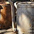 Oil Cans Picking by Gwyn Newcombe