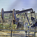 Oil Wells Pumping by Chuck Staley
