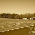 Old Barn And Farm Field In Sepia by Chris W Photography AKA Christian Wilson