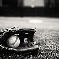 Old Baseball And Glove On Field by Danny Hooks