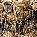 Old Farm Tractor In Sepia 1 by Douglas Barnett