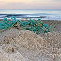 Old Fishing Net On Beach by Lee Serenethos