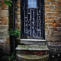 Old Forgotten Black Front Door by Doc Braham